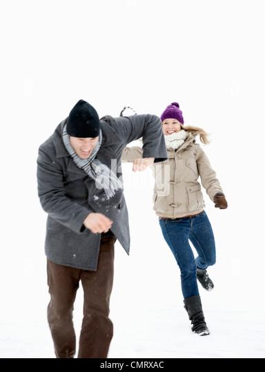 Two throwing snowballs - Stock Image