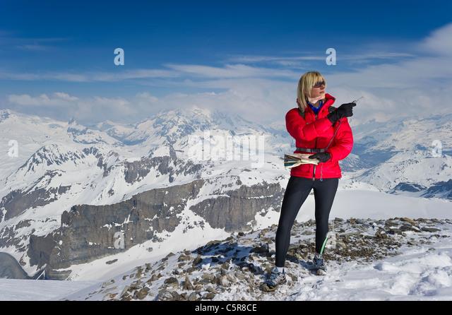 A women orienteering in high altitude mountains. - Stock-Bilder