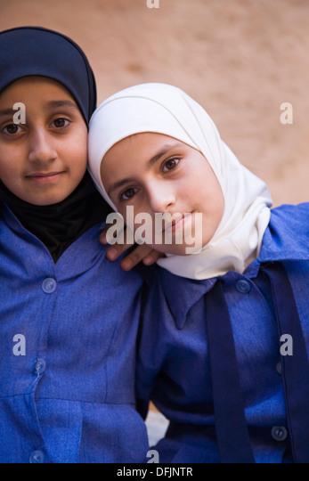 Jordanian school kids on a field trip to the legendary 3rd century Nabataean city of Petra, Jordan. - Stock Image