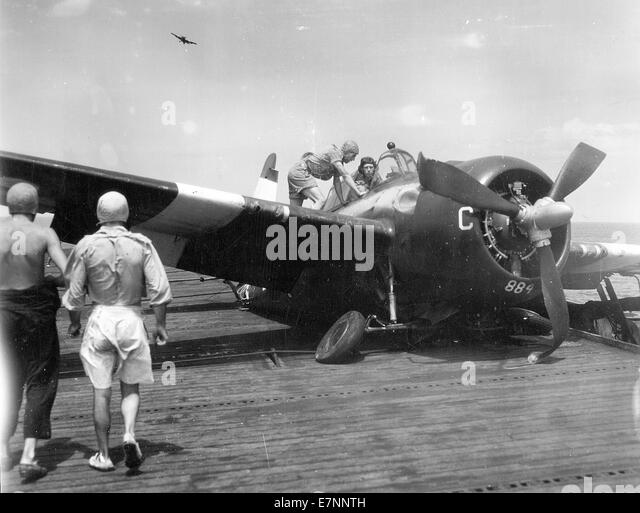 Royal Navy Grumman Martlet later called Wildcat aircraft following a crash on the flight deck - Stock Image