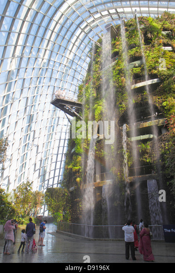 Singapore Gardens by the Bay park Cloud Forest mountain greenhouse waterfall Asian family - Stock Image