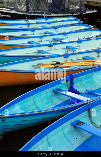 Blue rowing boats - Stock Image