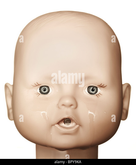 crying baby doll head on a white background - Stock Image
