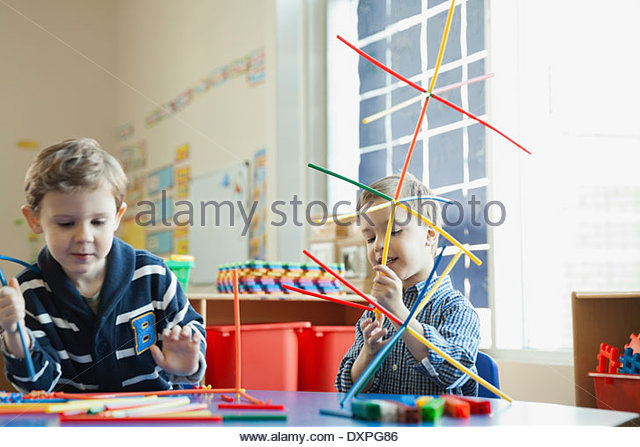 Kids playing in elementary school - Stock Image