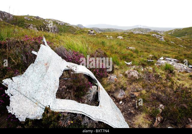USAAF Liberator fuselage door lying on hillside crash site. - Stock Image