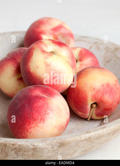 peaches in a bowl. - Stock Image