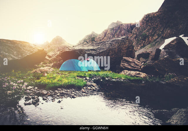 Mountains Landscape and tents camping Travel Lifestyle concept Summer vacations outdoor - Stock Image