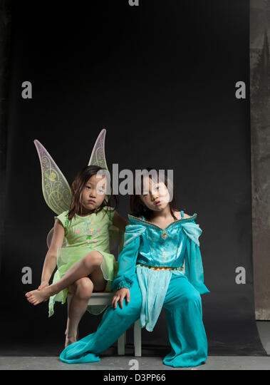 Young Asian twins dancing and performing gymnastics. - Stock Image