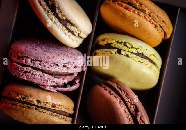 Macaroons In Box On Table - Stock Image