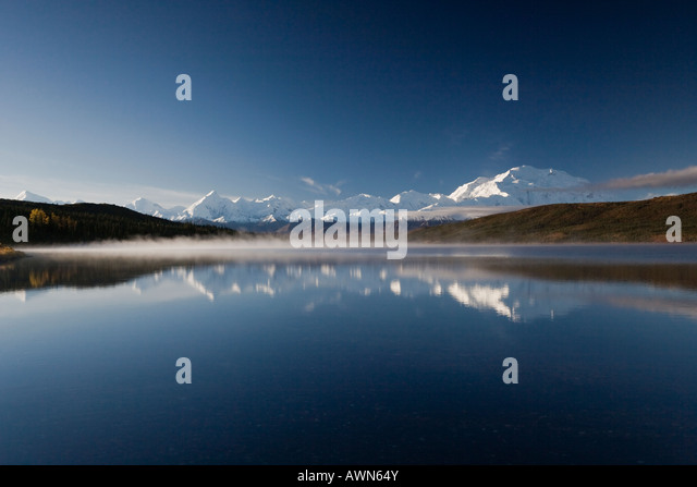 Perfect reflection of Mt Denali in the crisp, misty waters of Wonder Lake in Denali National Park, Alaska - Stock Image