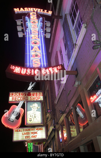 Nashville Tennessee Music City USA downtown Lower Broadway business strip neon light sign Ernest Tubb Record Shop - Stock Image