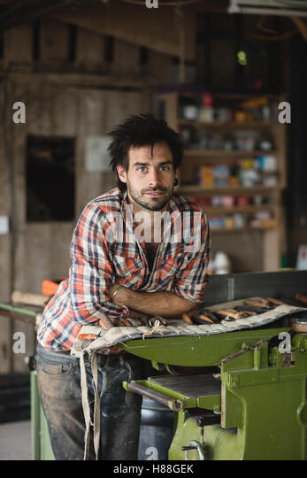 Environmental portrait of a carpenter in his workshop - Stock-Bilder
