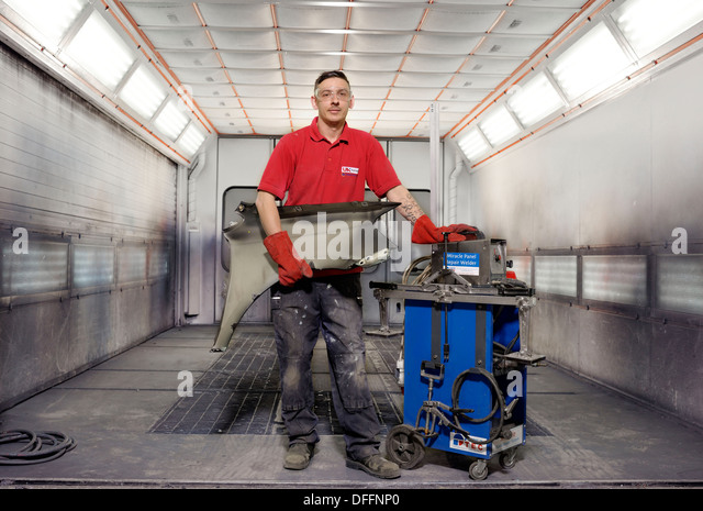 A Portrait of a Panel Beater at an Accident Repair Centre - Stock Image