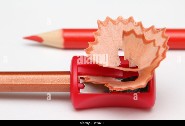 With a red pencil-sharpener and shavings. - Stock Image