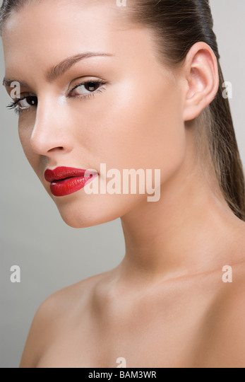 Beautiful woman wearing red lipstick - Stock Image