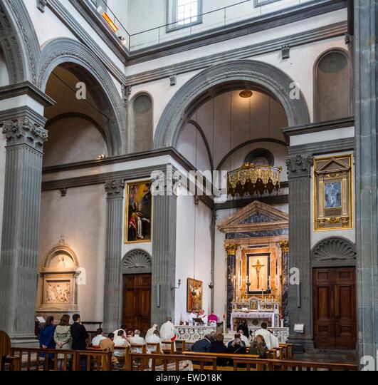 mass in side chapel, Basilica of San Lorenzo, Florence, Italy - Stock Image