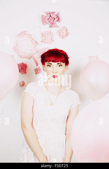 Beautifully romantic red haired girl in a contemporary studio setting - Stock-Bilder