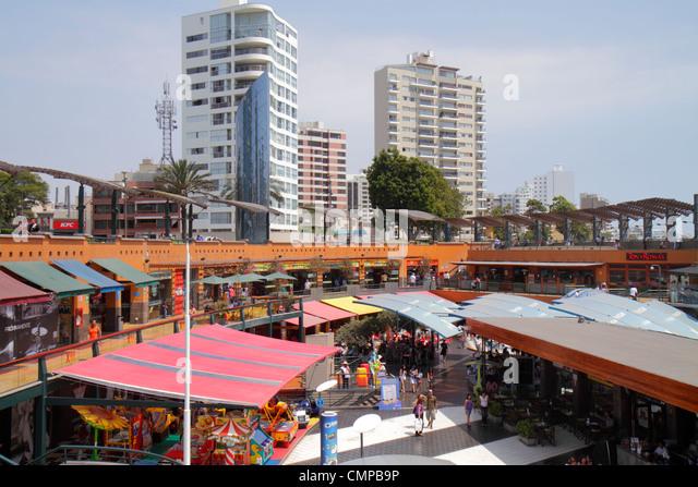 Lima Peru Miraflores Malecon de la Reserva Larcomar shopping dining lifestyle center centre dining luxury high-rise - Stock Image