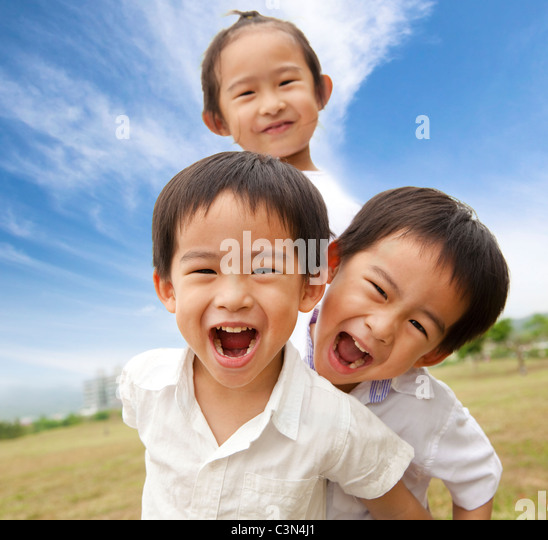 Portrait of happy kids outdoor - Stock Image
