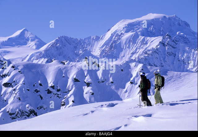 Man and woman enjoying the view in Tordrillo's, Alaska. - Stock Image