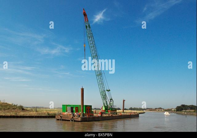 Barge with crane Norfolk Broads UK - Stock Image