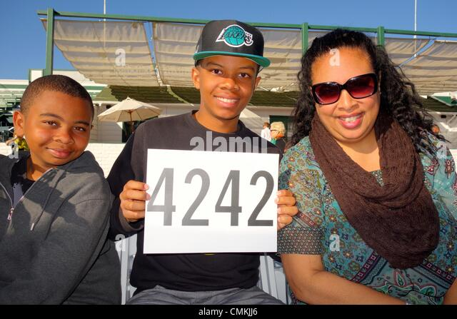 Oprah's auction - Riley, Roman and Carna came from Calabasas, California to attend the auction. - Stock Image
