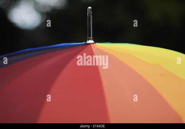 Rainbow Umbrella - Stock Image