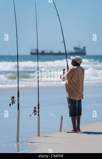 Surf fishing rod stock photos surf fishing rod stock for Florida surf fishing