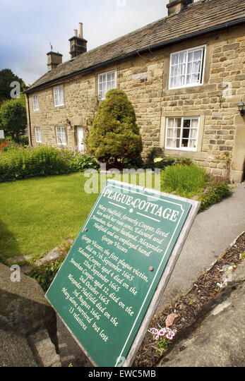 A row of 'plague cottages' where families affected by a plague died in Eyam village, Peak District, Derbyshire, - Stock Image
