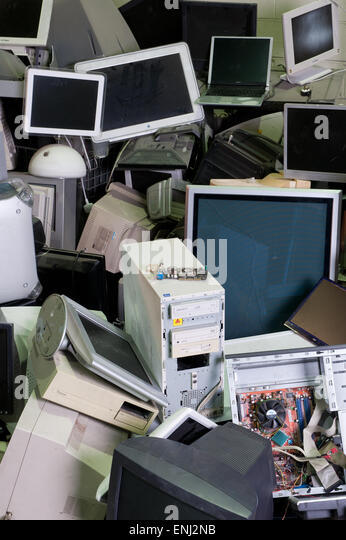 discarded computers in a pile at dump - Stock Image