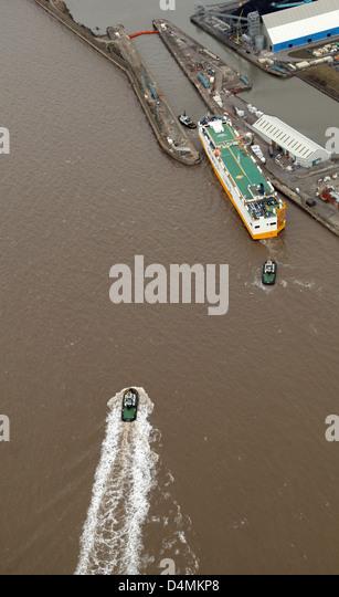 aerial view of  a Grimaldi Line ship entering Gladstone Docks via a lock in Liverpool - Stock Image