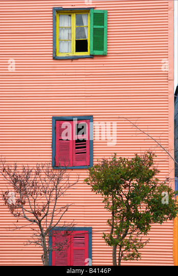 House made of corrugated iron with colorful shutters - Stock Image