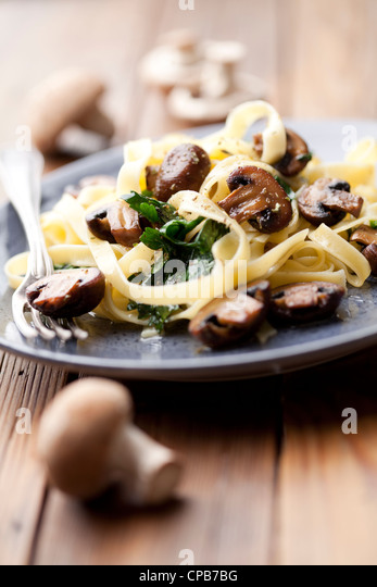 tagliatell with spinach and mushrooms - Stock Image