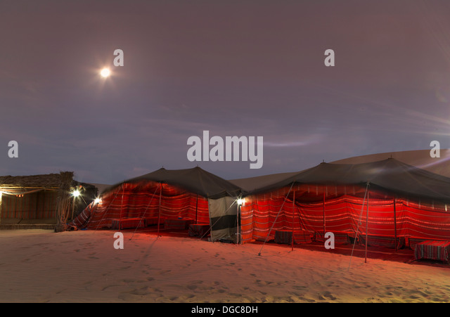 Bedouin tents at night in desert, Adu Dhabi, United Arab Emirates - Stock Image