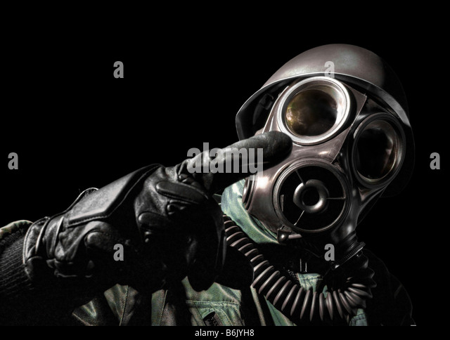 Gas masked man pointing - Stock Image