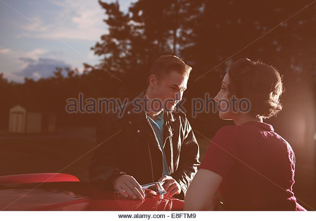Young couple by vintage car - Stock-Bilder