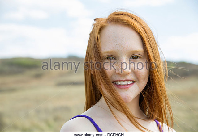 Portrait of happy schoolgirl looking at camera - Stock-Bilder