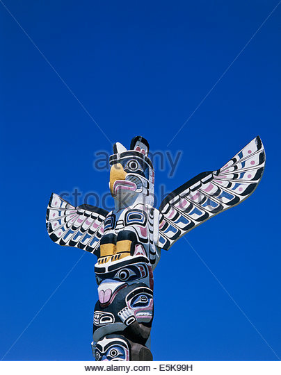Totem Pole Thunderbird tops the  by Ellen Neel at Brockton Pont in Stanley Park in Vancouver British Columbia Canada - Stock-Bilder