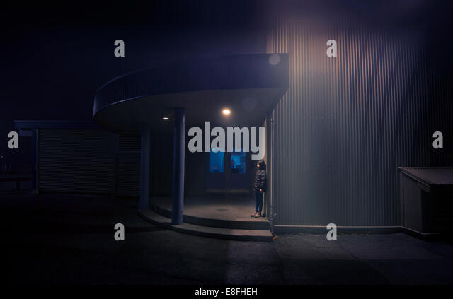 Canada, British Columbia, Greater Vancouver Regional District, Vancouver, Girl (8-9) in school ground at night - Stock Image