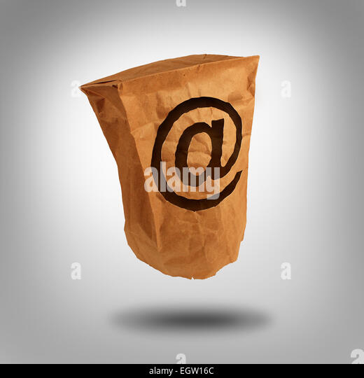 Digital identity and private or anonymous social network user on the internet as a brown paper bag with a hole shaped - Stock Image