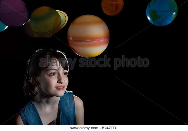 Portrait of a girl and planets - Stock Image
