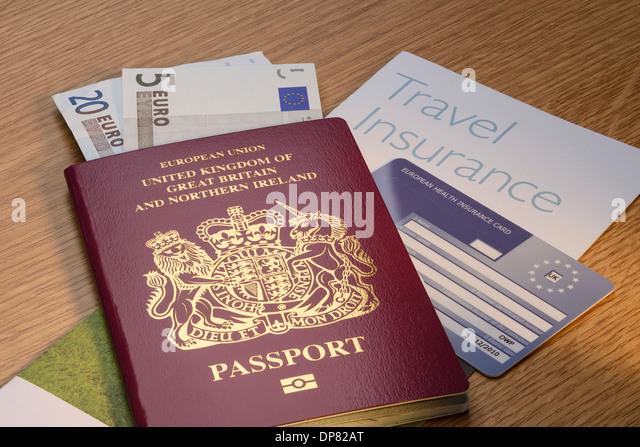 UK British passport with Euro money and travel insurance and an EHIC card - Stock-Bilder