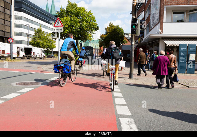 Cyclists crossing a road in Bremen, Germany. - Stock Image