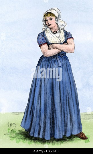 Young Dutch woman in traditional dress. - Stock Image