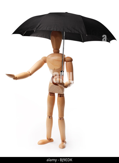 Wooden man holding an umbrella. Object on a white background. - Stock Image