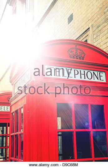 sunshine on phone box - Stock Image
