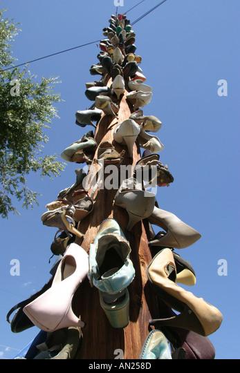 Albuquerque New Mexico shoe covered telephone pole - Stock Image