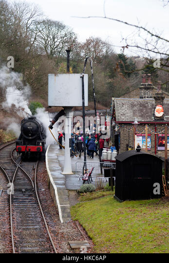 Oxenhope Station with steam train and visitors, Oxenhope, West Yorkshire - Stock Image