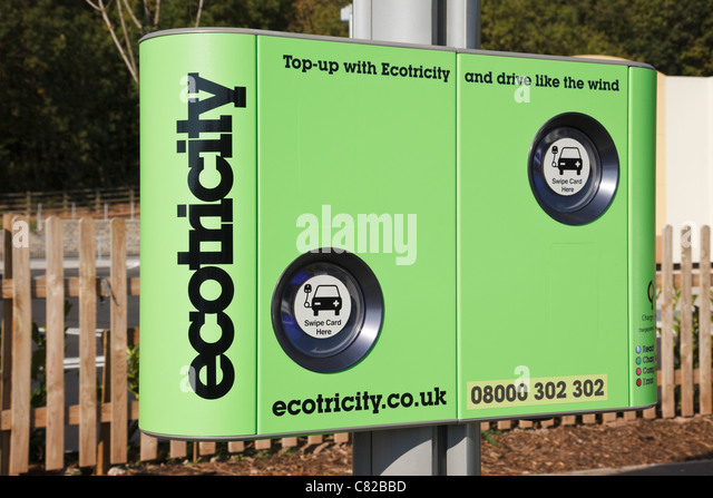 England, UK, Britain. Ecotricity charging point for recharging electric battery powered vehicles in a motorway service - Stock Image