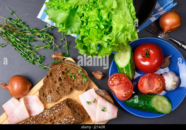 Top view: bread with bacon. Ingredients. Vegetables - Stock Image